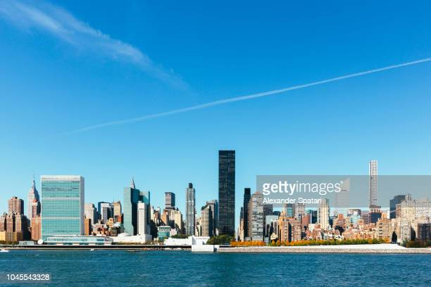 New York City skyline and East River on a sunny day, NY, United States