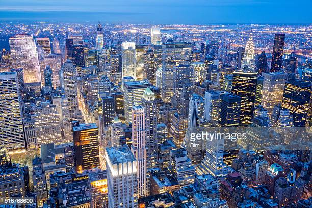 new york city skyline, manhattan, aerial view at night - new york skyline stock photos and pictures