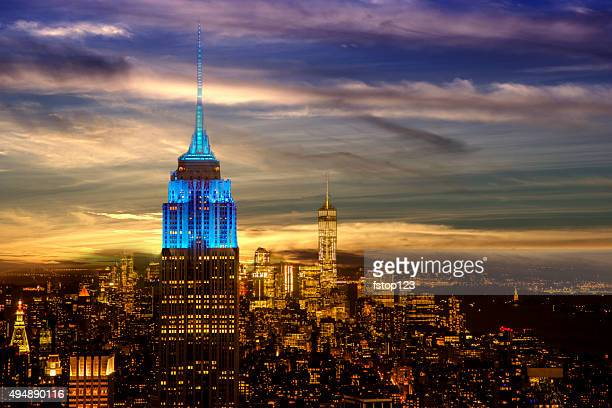 new york city skyline. night. empire state building. twilight sky. - empire state building stock pictures, royalty-free photos & images