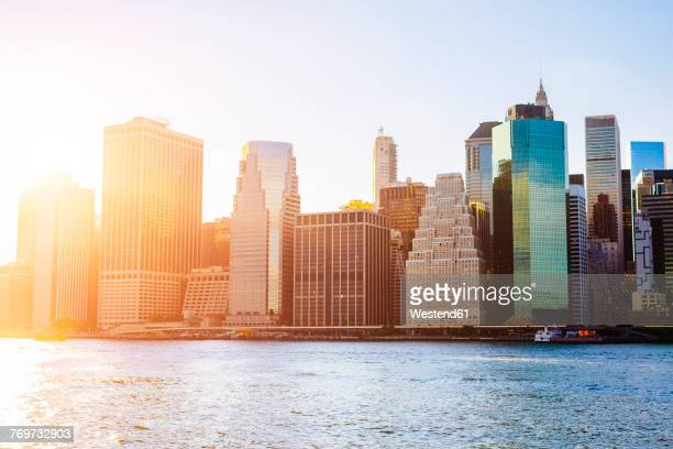 USA, New York City, skyline of Manhattan at sunset