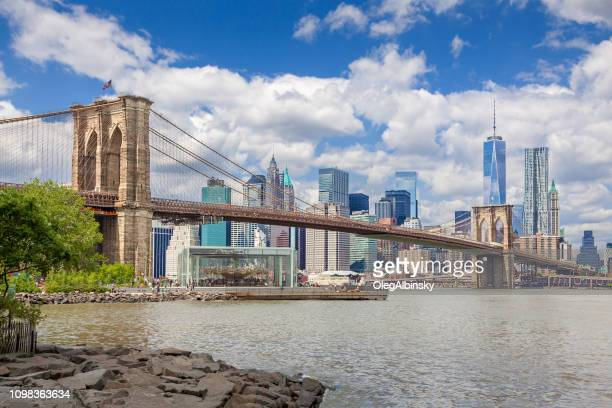 new york city skyline with brooklyn bridge, world trade center, beekman tower and woolworth building, ny, usa. - brooklyn bridge stock pictures, royalty-free photos & images