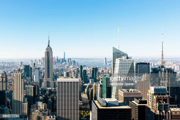 New York City skyline with clear blue sky, NY, United States
