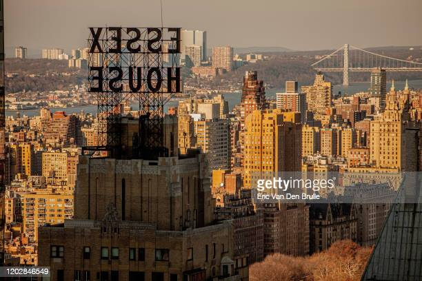 new york city skyline with essex house hotel sign. - eric van den brulle stock pictures, royalty-free photos & images
