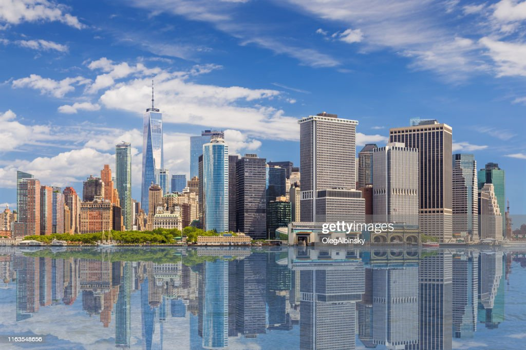 New York City Skyline with Manhattan Financial District and World Trade Center Reflected in Water of New York Harbor, NY, USA. : Stock Photo