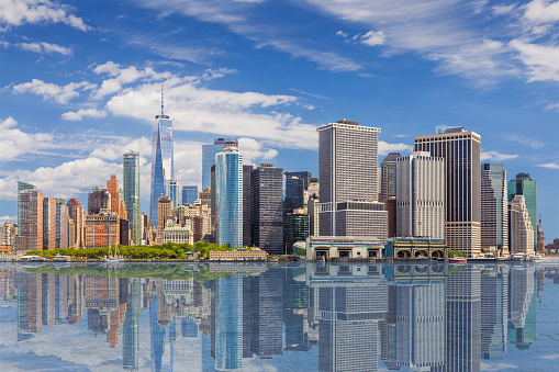 New York City Skyline with Manhattan Financial District and World Trade Center Reflected in Water of New York Harbor, NY, USA. 1163548656