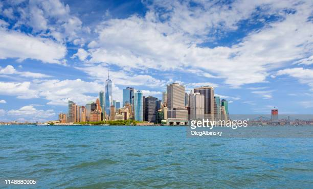 New York City Skyline with Manhattan Financial District, World Trade Center and Water of New York Harbor, NY, USA.