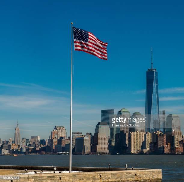 New York City skyline with waving American flag