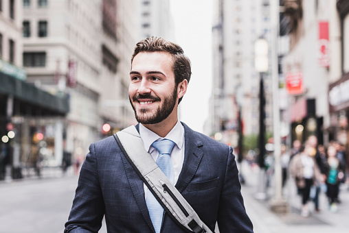 USA, New York City, smiling businessman in Manhattan - gettyimageskorea