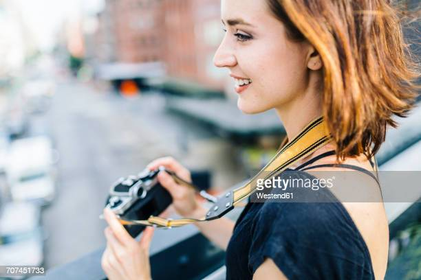 usa, new york city, smiling woman with camera on the high line in manhattan - strap stock pictures, royalty-free photos & images