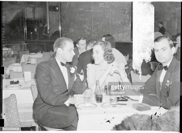 New York City: Socialites On Night Club Outing. Billy Livingston and Willa Blake, socialites, pictured April 6 at the Kit Kat Club here. Miss Blake...