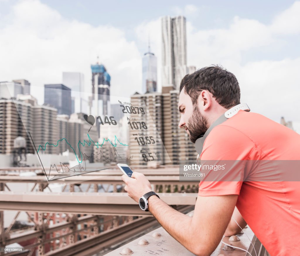 Usa New York City Sportive Young Man Having A Break Checking Data Emerging From Smartphone High Res Stock Photo Getty Images