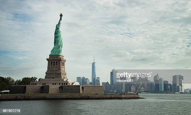 USA, New York City, Statue of Liberty on Liberty Island and skyline in background