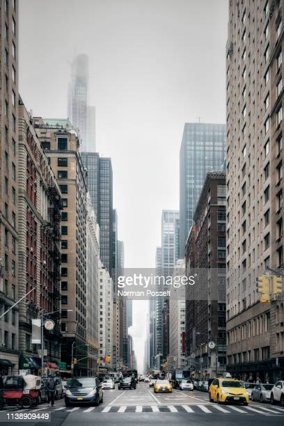 new york city street and buildings, sixth avenue, new york, usa - sixth avenue stock pictures, royalty-free photos & images