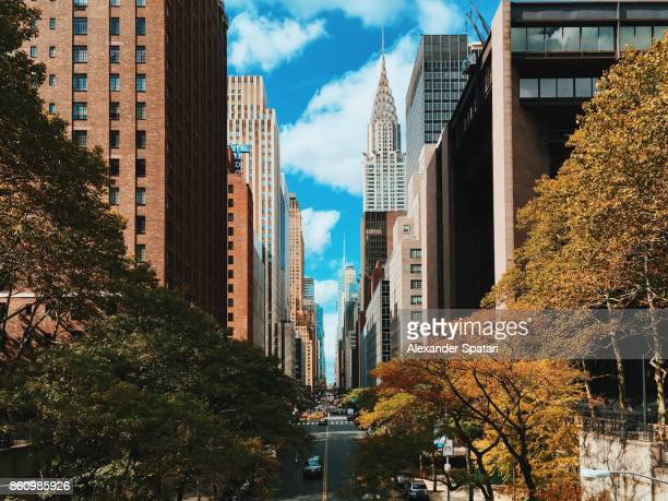 New York city street in Midtown Manhattan and Chrysler Building, NY, USA