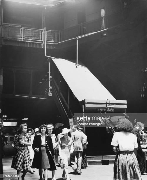 New York City street scene showing raised entrance steps 1941