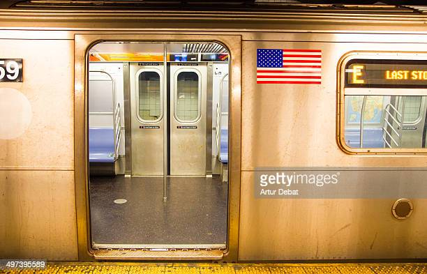 new york city subway open train with usa flag - subway stock pictures, royalty-free photos & images