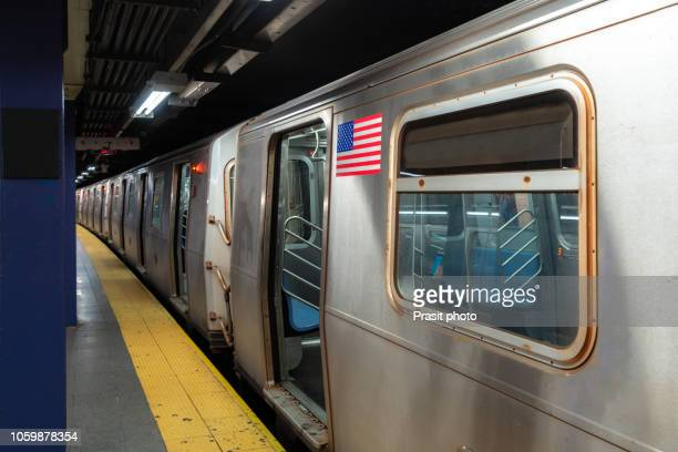 new york city subway train parking in platform at new york city, usa. - subway stock pictures, royalty-free photos & images