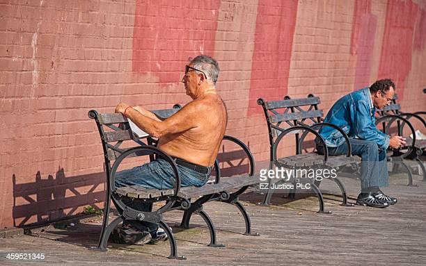 New York City, sunbathing on the Brooklyn waterfront.