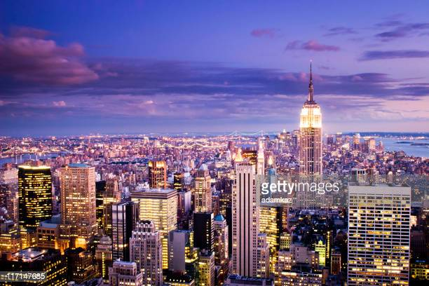 new york city sunset - new york skyline stock photos and pictures