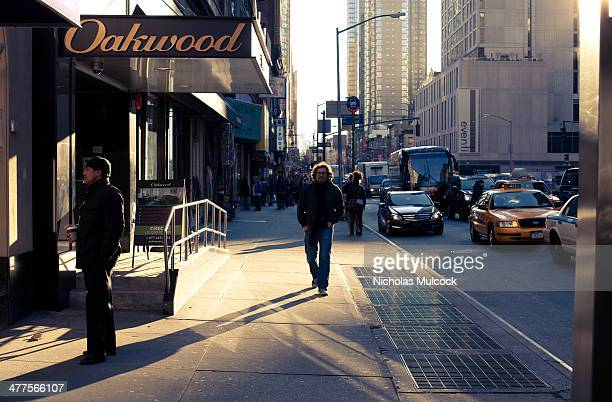 CONTENT] New York City sunshine commuter shadow cold brisk traffic sidewalk avenue street taxi eventi hotel oakwood