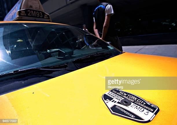New York City Taxi and Limousine Commission medallion sits on the hood of a taxi in New York Tuesday May 29 2007 New York City taxi medallions the...