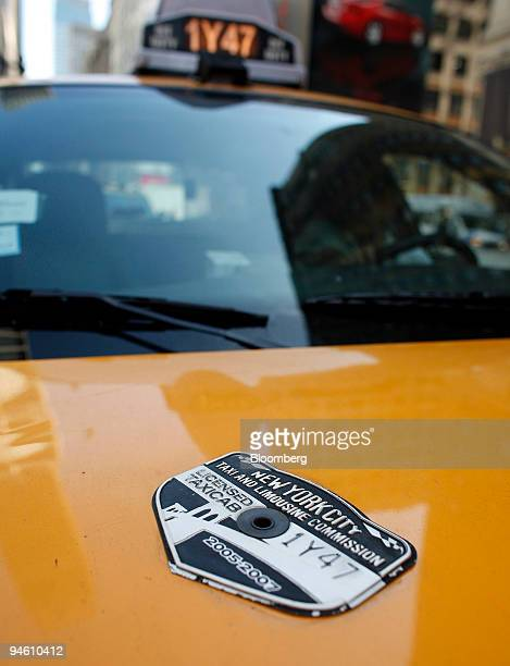 New York City Taxi Limousine Commission medallion adorns the hood of a taxi in New York US on Sept 5 2007 Some of New York City's estimated 20000...