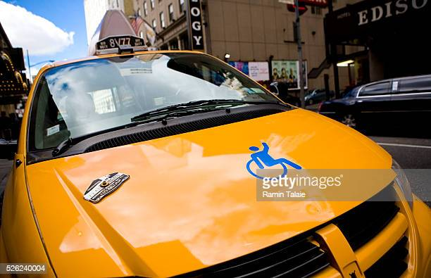 A New York City taxi with wheelchair access capability drives in Manhattan on Sunday September 13 2009 in New York City