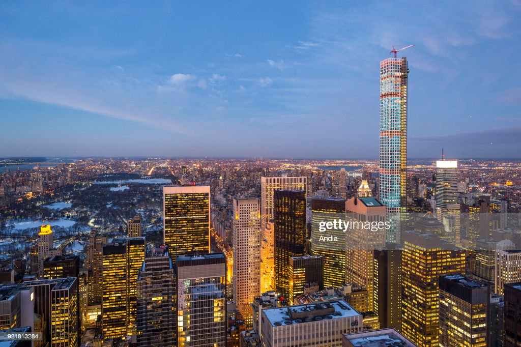 the city lit up at night, buildings and 432 Park avenue under construction, one of the tallest residential skyscrapers in New York City.
