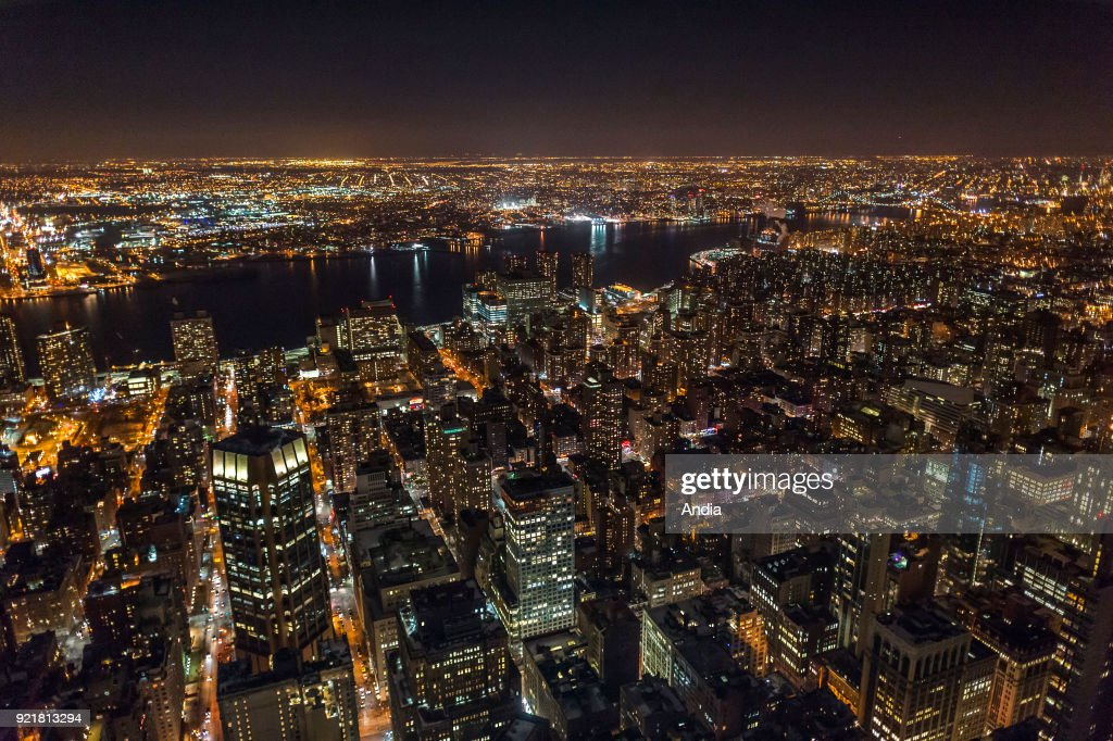 the city lit up at night, buildings viewed from the Empire State Building.