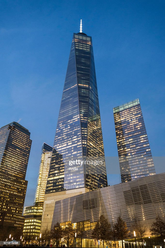 the city lit up at night, with the new One World Trade Center, 1WTC, also known as the Tower 1 or Freedom Tower, in Manhattan.
