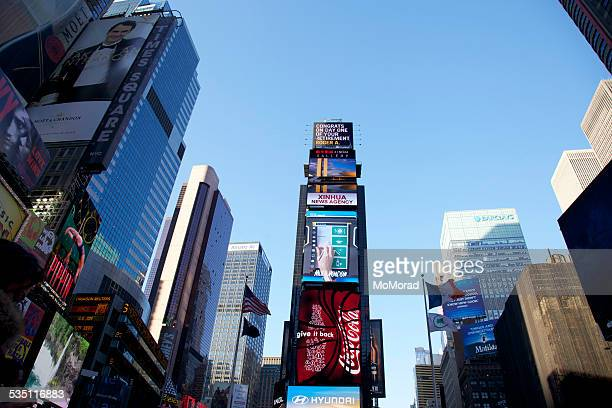 new york city times square - ernst & young stock photos and pictures