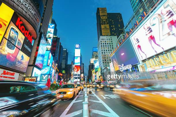 new york city times square yellow cab traffic - new york celebrity stock photos and pictures