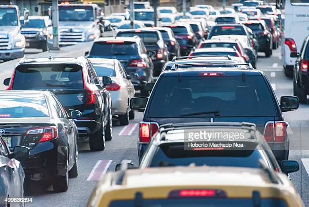 New York city traffic jam Cars stuck in heavy traffic jam moving one behind the other in the city of New York USA New York City has heavy traffic and...