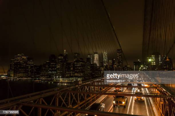 usa, new york city, traffic on bridge at night - yellow taxi stock pictures, royalty-free photos & images