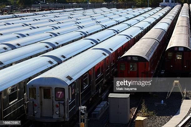 CONTENT] New York City Transit subway cars parked at the Casey Stengel rail yards in Queens NY The image features the newer R62A as well as the...