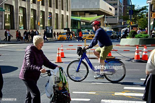 New York City, Urban Life, Elderly Woman,  Bicyclist on Broadway