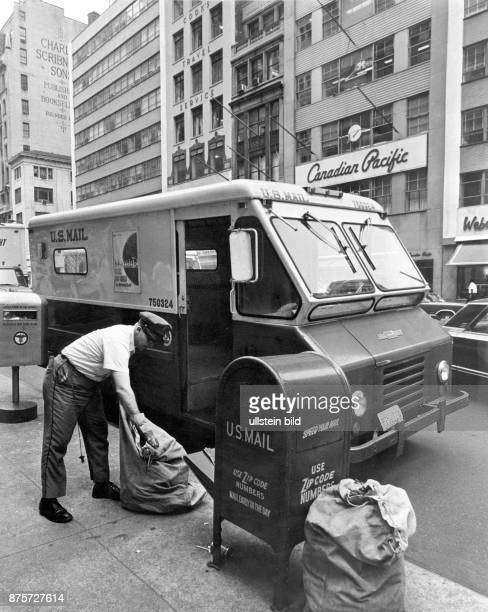 New York City US Mail man clearing the letterbox