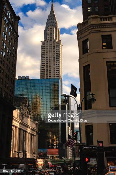 new york city, usa - looking skywards from street level in midtown manhattan towards the chrysler building. vertical image; no people - madison avenue stock pictures, royalty-free photos & images