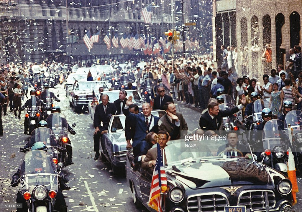 New York City welcomes the Apollo 11 crew in a showering of ticker tape down Broadway and Park Avenue August 13, 1969 in a parade termed as the largest in the city's history. Pictured in the lead car, from the right, are astronauts Neil A. Armstrong, commander; Michael Collins, command module pilot; and Edwin E. Aldrin Jr., lunar module pilot. The three astronauts teamed for the first manned lunar landing on July 20, 1969. The 30th anniversary of the Apollo 11 Moon mission is celebrated July 20, 1999.