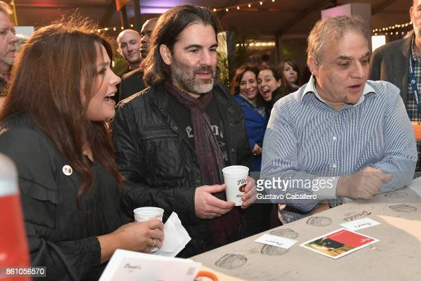 New York City Wine Food Festival Founder Executive Director Lee Brian Schrager chef Racheal Ray and John M Cusimano attend the Food Network Cooking...