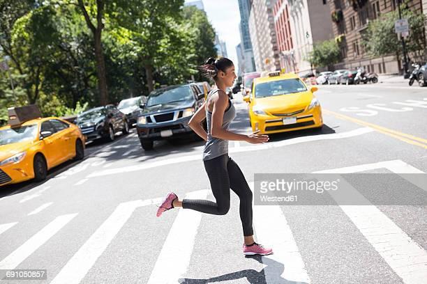 USA, New York City, woman running on urban street