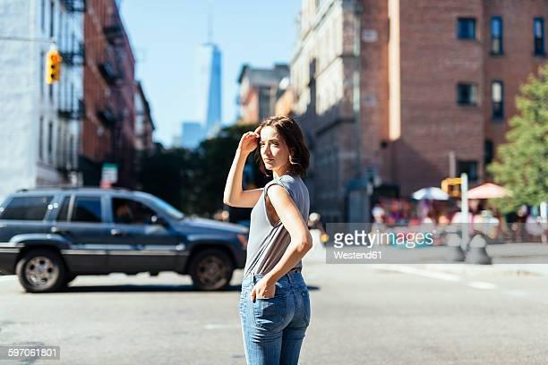 USA, New York City, woman standing on a street