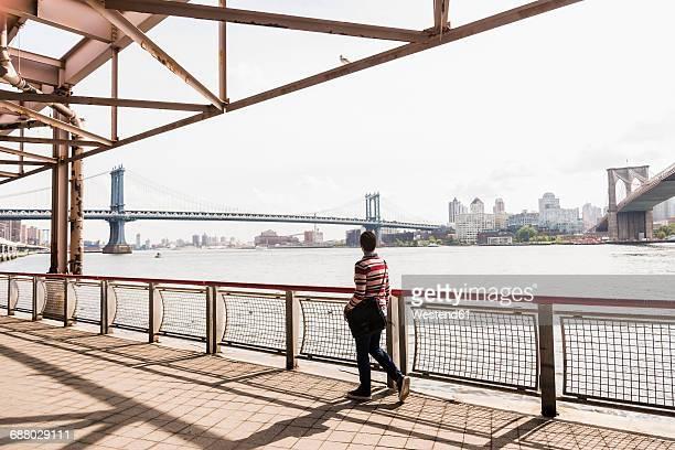 USA, New York City, woman walking at East River