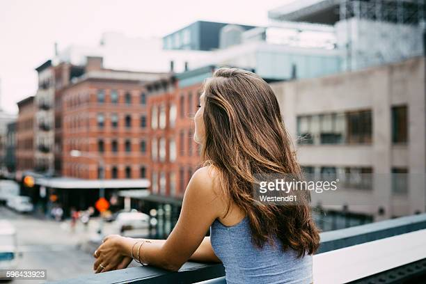 USA, New York City, young woman enjoying the view of the city