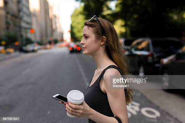 USA, New York City, young woman on the go in Manhattan