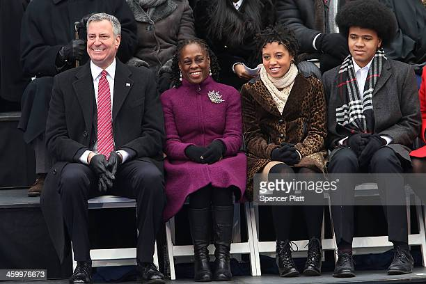 New York City's 109th Mayor Bill de Blasio sits on stage with his family Chiara de Blasio Dante de Blasio and wife Chirlane McCray at City Hall on...