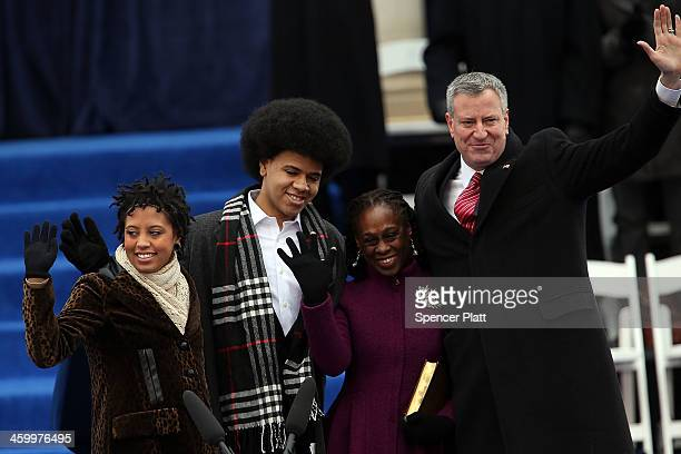 New York City's 109th Mayor Bill de Blasio stands on stage with his family Chiara de Blasio Dante de Blasio and wife Chirlane McCray at City Hall on...