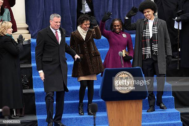 New York City's 109th Mayor Bill de Blasio walks onto stage with his family his family Chiara de Blasio Dante de Blasio and wife Chirlane McCray at...