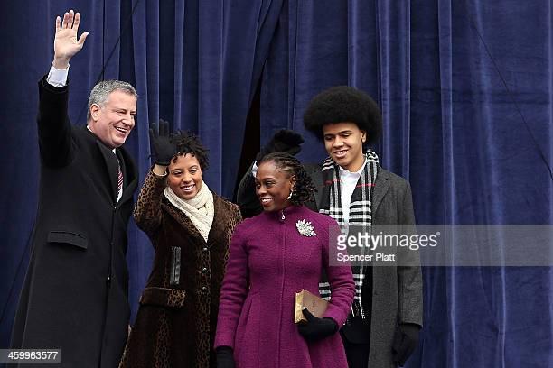 New York City's 109th Mayor Bill de Blasio walks onto stage with his family his family Chiara de Blasio Dante de Blasio and wife Chirlane McCray at...
