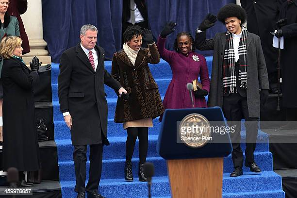 New York City's 109th Mayor Bill de Blasio walks onto stage with his family Chiara de Blasio Dante de Blasio and wife Chirlane McCray at City Hall on...